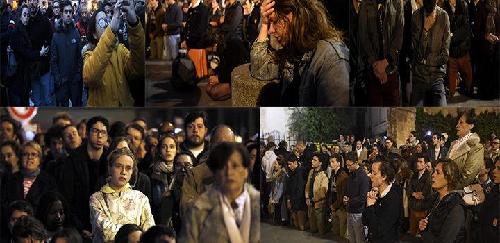 Parisinos cantan y lloran alrededor de Notre Dame